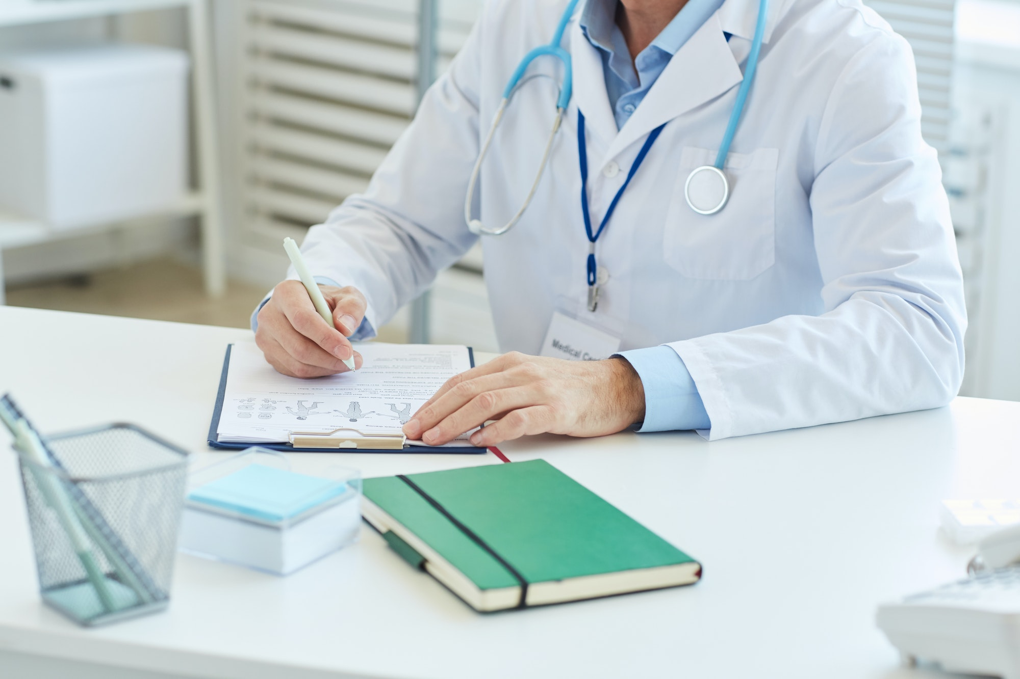 Doctor Filling Patients Report in Clinic